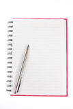 Pen over note book Royalty Free Stock Photo