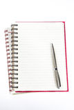 Pen over note book Stock Images