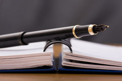 Pen over a notepad Royalty Free Stock Photo