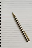 Pen over paper Stock Photo