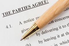 Pen over a printed agreement Stock Photography