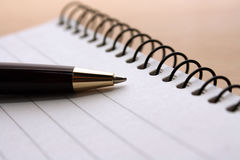 Pen and Pad. A Pen on a writing pad Stock Image