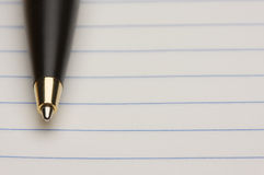 Pen and Pad of Paper. Pen and Pad of Lined Paper Royalty Free Stock Images