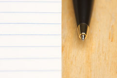 Pen and Pad of Paper Stock Image