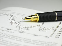 Pen on page. A ballpoint pen on a page of a book showing a chart trend royalty free stock images