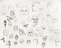 Pen painted portraits on the paper. stock images