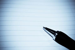 Pen on paper Royalty Free Stock Images