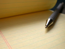 Pen and Paper. Yellow pad with pen Royalty Free Stock Image