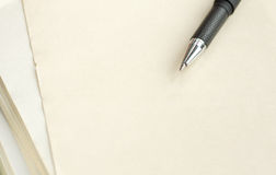 Pen on a paper. Black pen on a paper. Macro Stock Photo