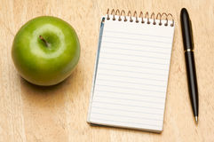 Pen, Paper and Apple Stock Image