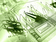 Pen and paper-clipses against the graph (greens) Stock Photo