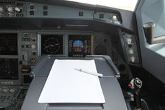 Pen and paper in cockpit Royalty Free Stock Images