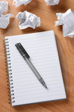 Pen on Paper With Crumpled Wads Royalty Free Stock Images