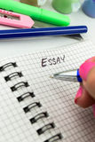 Pen and paper  Essay Writing. Close up Royalty Free Stock Photo