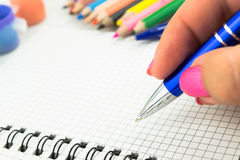 Pen and paper  Essay Writing. Close up Stock Images