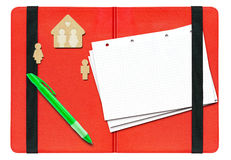Pen, paper and figures on a red folder Royalty Free Stock Photography