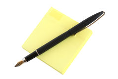 Pen On Paper. Fountain pen on yellow sticky notes. Isolated with clipping path Stock Image