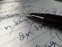 Pen on paper Royalty Free Stock Image