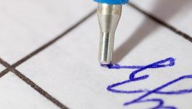 Pen on paper. macro stock photos