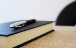 Pen with paper notepad on the table. Photo of pen with paper notepad on the table royalty free stock photography