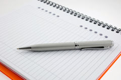 Pen and paper orange notebook Royalty Free Stock Images