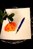 Pen Paper and Rose Royalty Free Stock Photo