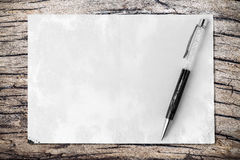 Pen on paper texture background. Business concept. Royalty Free Stock Image