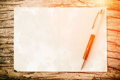 Pen on paper texture background with light and flare. Business c Royalty Free Stock Image