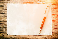 Pen on paper texture background with light and flare. Business c Royalty Free Stock Photography