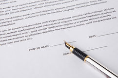 Pen on a paper to sign Royalty Free Stock Photo