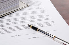 Pen on a paper to sign Royalty Free Stock Photos