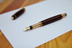 Pen and paper Stock Photos