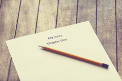 Pen and paper for writer. Pencil and paper for writer. Photo in retro color style Stock Image