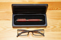 Pen, pen holster and glasses Royalty Free Stock Photo