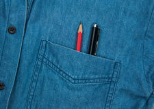 Pen and pencil. Jeans shirt pocket with pen and pencil Royalty Free Stock Photos