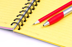 Pen pencil and notebook. Isolated on white Royalty Free Stock Photos