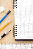 Pen, pencil and notebook on wood Royalty Free Stock Photos