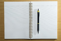 Pen,pencil and notebook on wooden table. Top view Royalty Free Stock Image