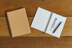 Pen, pencil and notepad. flat lay style. Pen, pencil and empty notepad or notebook. flat lay style stock photo