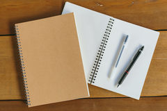 Pen, pencil and notepad. flat lay style. Pen, pencil and empty notepad or notebook. flat lay style royalty free stock photo
