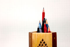 Pen pencil in stand. Pen pencil pointed upwards in wooden stand Stock Photo