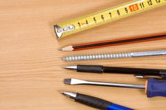 Pen, pencil and tape measure Royalty Free Stock Photography