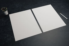 Pen, pencils and paper sheets. Two blank white paper sheets, pen and pencils in cup on dark desktop. Mock up, 3D Rendering royalty free illustration