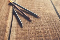 Pen and pencils on vintage wooden table royalty free stock photos