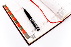 Pen on personal organizer Royalty Free Stock Photos