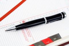 Pen on personal organizeri Royalty Free Stock Photography