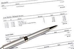 Pen On Phone Bill. Silver Pen On A Monthly Phone Bill Statement, Business Background Stock Images