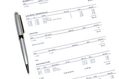 Pen On Phone Bill. Silver Pen On A Monthly Phone Bill Statement, Business Background Royalty Free Stock Photography