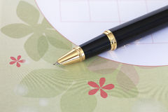 A pen on a piece of paper Royalty Free Stock Image