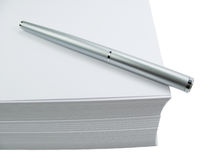 Pen on pile of paper Royalty Free Stock Image
